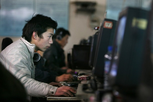 Chinese internet users go online at an internet shop in Beijing